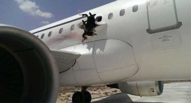 Video Surveillance Captures Airport Workers with Laptop Used in Somalia In-Flight Jet Blast
